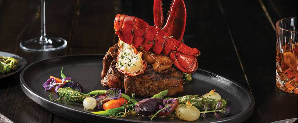 The carnivorous delights are abundant—like rib-eyes, a wagyu rib cap and a majestic 32-ounce tomahawk—and the other half of the menu boasts seafood flown in daily.